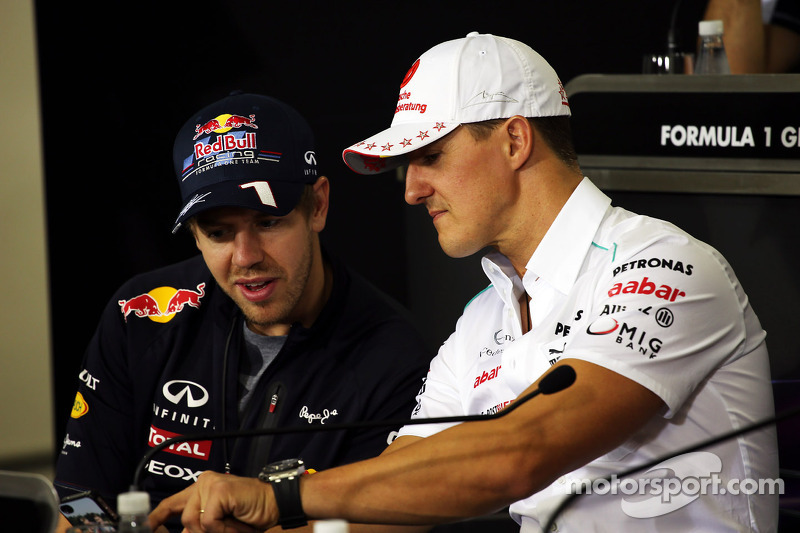 Sebastian Vettel, Red Bull Racing, und Michael Schumacher, Mercedes AMG F1, in der FIA-Pressekonfere