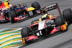Pedro De La Rosa, HRT Formula 1 Team leads Mark Webber, Red Bull Racing