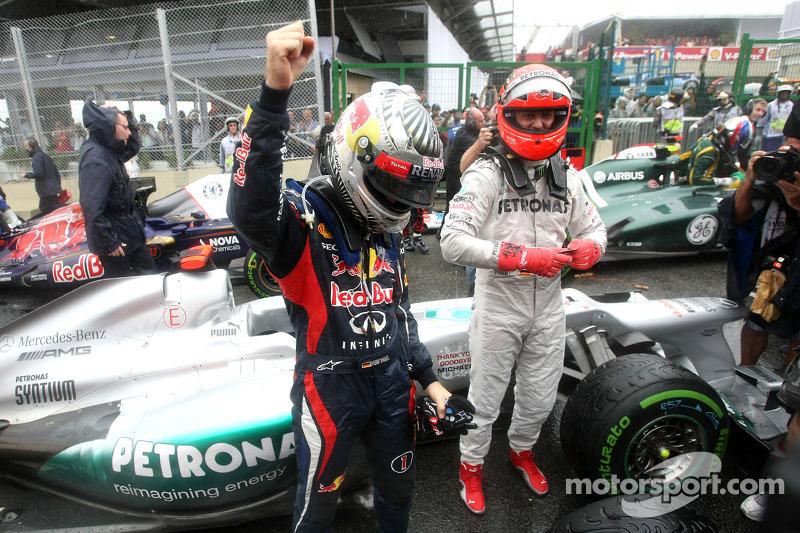 Чемпіон 2012 року Себастьян Феттель, Red Bull Racing і Міхаель Шумахер, Mercedes GP