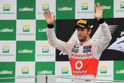 Race winner Jenson Button, McLaren celebrates on the podium