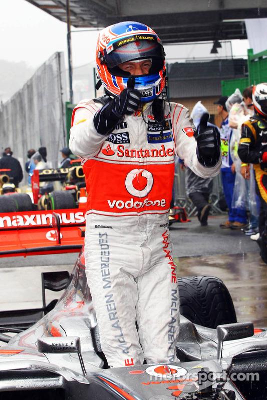Race winner Jenson Button, McLaren celebrates in parc ferme