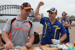 Craig Lowndes and Lee Holdsworth taking part in the Ford vs Holden challenge on Sydney Harbour