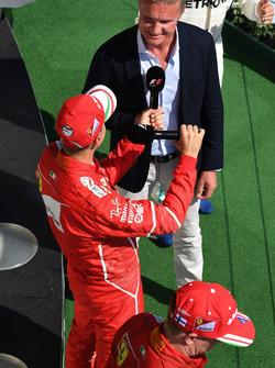 Sebastian Vettel, Ferrari and David Coulthard, Channel Four TV Commentator on the podium