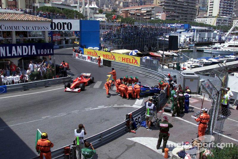 The crashed Prost Peugeot of Nick Heidfeld