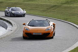 Sergio Perez arrives in a McLaren MP4-12C