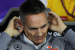 Martin Whitmarsh, McLaren Chief Executive Officer gets to grips with his microphone in the FIA Press