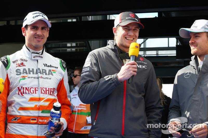 (L naar R): Adrian Sutil, Sahara Force India F1 met Nico Hulkenberg, Sauber en Nico Rosberg, Mercedes AMG F1