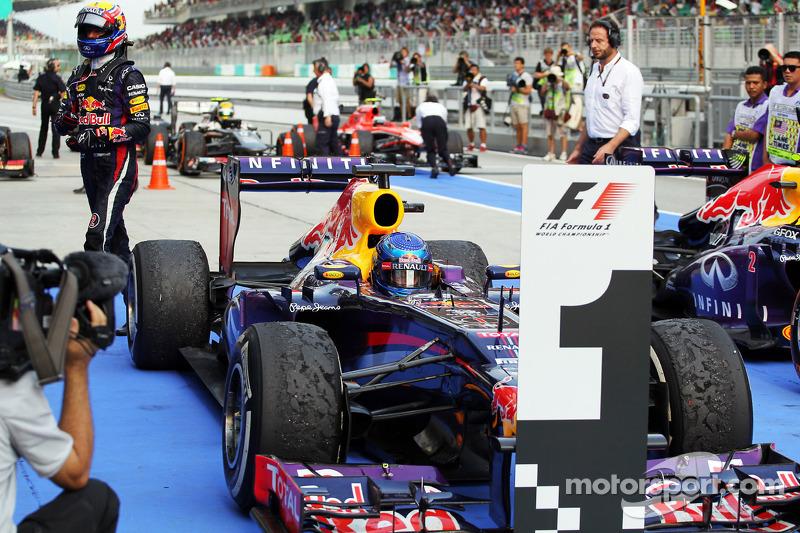 Race winner Sebastian Vettel, Red Bull Racing RB9 in parc ferme as team mate Mark Webber, Red Bull R