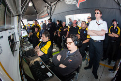 Corvette Racing team members watch qualifying