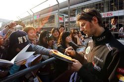 Romain Grosjean, Lotus F1 Team signs autographs for the fans