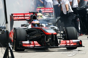 Jenson Button, McLaren MP4-28 leaves the pits as Sergio Perez, McLaren MP4-28 enters his pit box