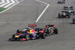 Mark Webber, Red Bull Racing RB9 leads Kimi Raikkonen, Lotus F1 E21 and Jenson Button, McLaren MP4-28
