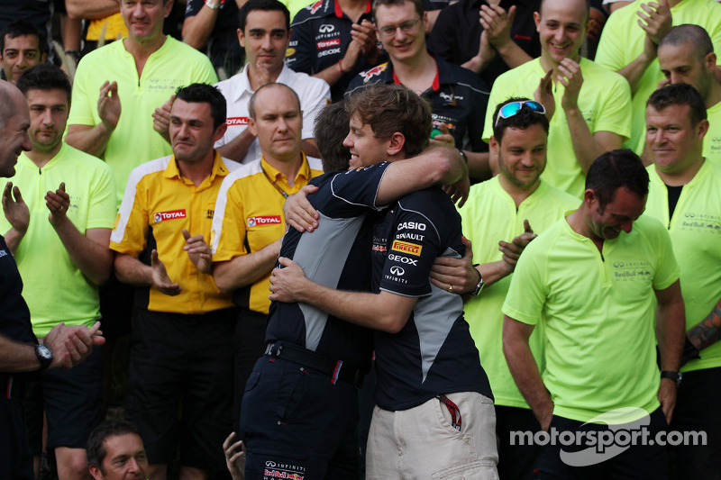 Race winner Sebastian Vettel, Red Bull Racing celebrates with Christian Horner, Red Bull Racing Team Principal and the team