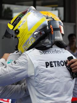 (L to R): Lewis Hamilton, Mercedes AMG F1 with pole sitter Nico Rosberg, Mercedes AMG F1 in parc ferme