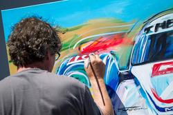 Painter putting final touches for Austin Hatcher donation piece
