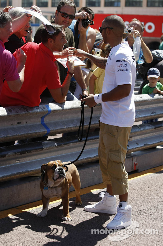 Lewis Hamilton, Mercedes AMG F1, with his dog Roscoe, signs autographs for the fans