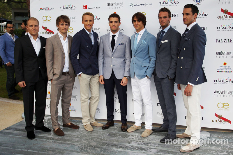 (L naar R): Valtteri Bottas, Williams; Charles Pic, Caterham; Max Chilton, Marussia F1 Team; Jules Bianchi, Marussia F1 Team; Esteban Gutierrez, Sauber; Giedo van der Garde, Caterham F1 Team; Adrian Sutil, Sahara Force India F1, bij Amber Lounge Fashion