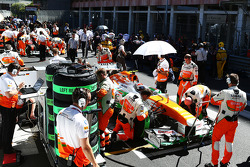 Adrian Sutil, Sahara Force India VJM06 on the grid as the race is stopped