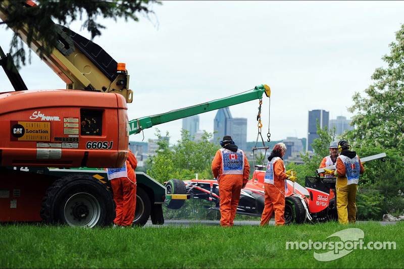 The Marussia F1 Team MR02 of Jules Bianchi, Marussia F1 Team is recovered back to the pits on the ba