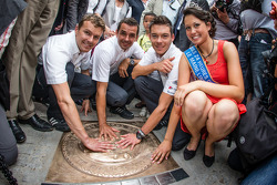 Hand imprint ceremony: 2012 24 Hours of Le Mans winners Marcel Fässler, Andre Lotterer and Benoit Tréluyer with Miss 24 Hours Le Mans 2013