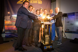 Frank Biela, Emanuele Pirro, Henri Pescarolo, ACO President François Fillon, Tom Kristensen, Jacky Ickx and Gérard Larousse with Miss Le Mans 2013