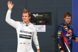 Nico Rosberg, Mercedes AMG F1 W04 and Sebastian Vettel, Red Bull Racing RB9