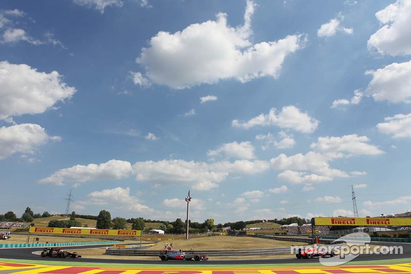 Jules Bianchi, Marussia F1 Team MR02 leads Jenson Button, McLaren MP4-28 and Romain Grosjean, Lotus