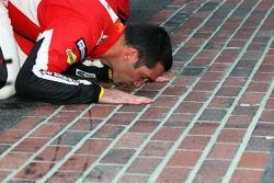GT winner Max Papis kisses the yard of bricks