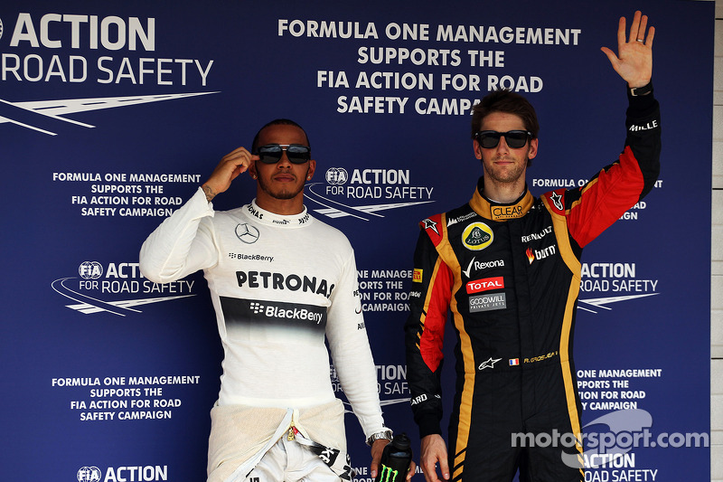 Pole sitter Lewis Hamilton, Mercedes AMG F1 with third placed Romain Grosjean, Lotus F1 Team in parc