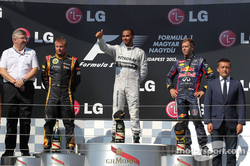 1st place Lewis Hamilton, Mercedes AMG F1 W04 with 2nd place Kimi Raikkonen, Lotus F1 E21 and 3rd pl