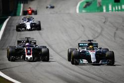 Lewis Hamilton, Mercedes AMG F1 W08, passes Romain Grosjean, Haas F1 Team VF-17