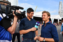 TV Presenter Vernon Kaye, Nico Rosberg in the paddock
