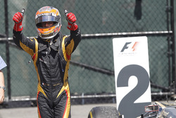 Romain Grosjean, Lotus GP, celebrates in Parc Ferme