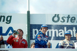 Podium: race winner Alain Prost, second place René Arnoux, third place Nelson Piquet