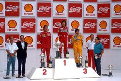 Podium: race winner Alain Prost, second place Gerhard Berger, third place Nelson Piquet
