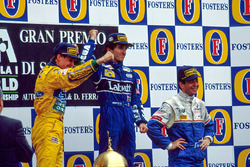 Podium: race winner Alain Prost, second place Michael Schumacher, third place Martin Brundle