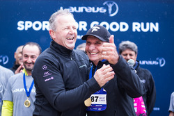 Emerson Fittipaldi is awarded with a medal by Laureus Academy Chairman Sean Fitzpatrick