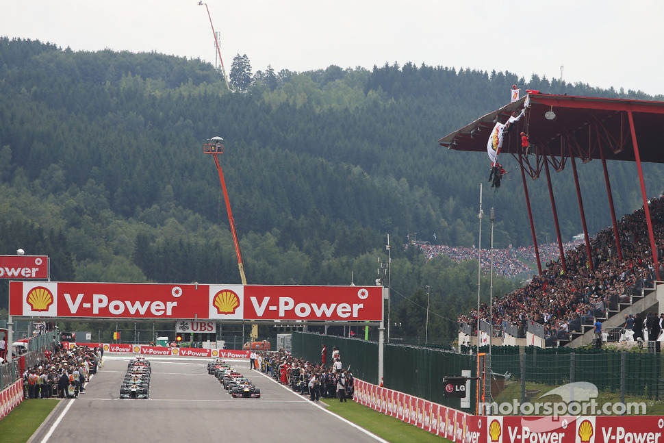 The grid before the start of the race as Greenpeace make a protest against race title sponsors Shell on the roof of the main grandstand