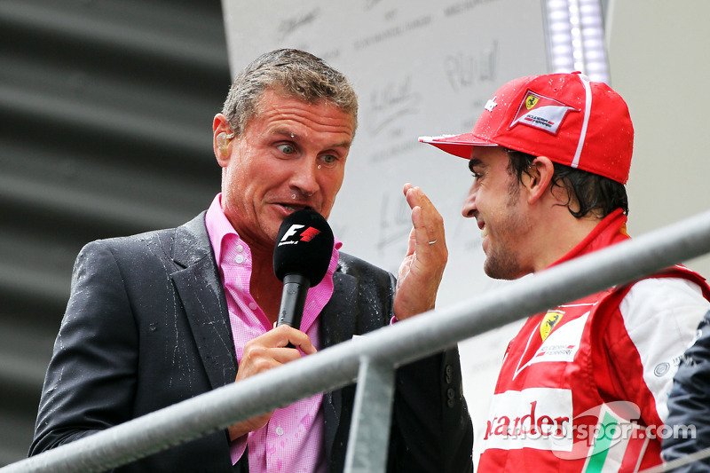 A wet David Coulthard, Red Bull Racing and Scuderia Toro Advisor / BBC Television Commentator with Fernando Alonso, Ferrari on the podium