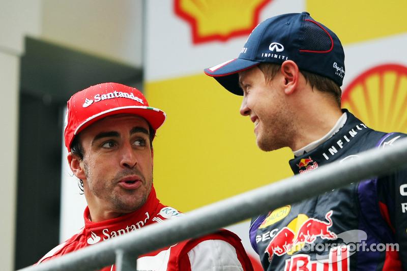 Fernando Alonso, Ferrari and race winner Sebastian Vettel, Red Bull Racing on the podium