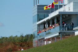 Ferrari fans watch from the new media building