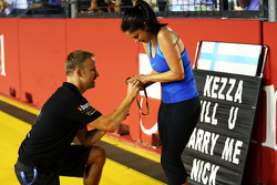 Romance in the paddock as a Red Bull Racing employee, accepts a marriage proposal from a Lotus F1 Team employee