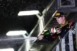 Kimi Raikkonen, Lotus F1 Team celebrates his third position with the champagne on the podium