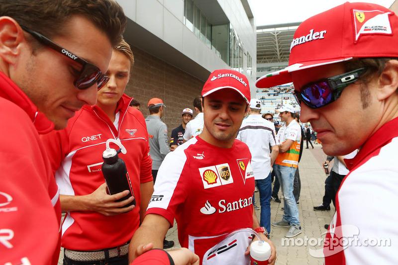 (L naar R): Jules Bianchi, Marussia F1 Team met Max Chilton, Marussia F1 Team, Felipe Massa, Ferrari