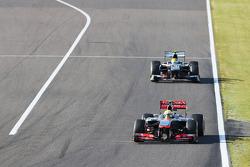 Sergio Perez, McLaren MP4-28 leads Esteban Gutierrez, Sauber C32