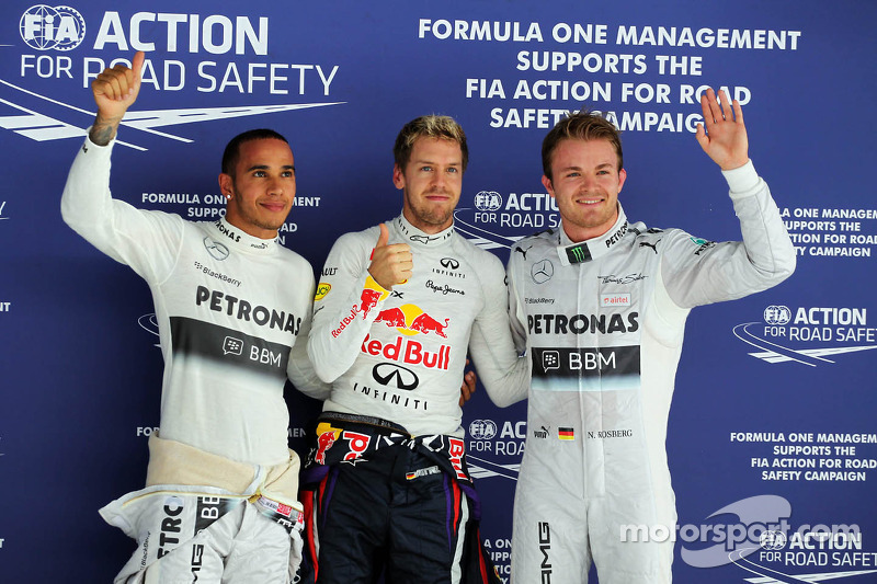 Qualifying top three in parc ferme: Nico Rosberg, Mercedes AMG F1, second; Sebastian Vettel, Red Bul