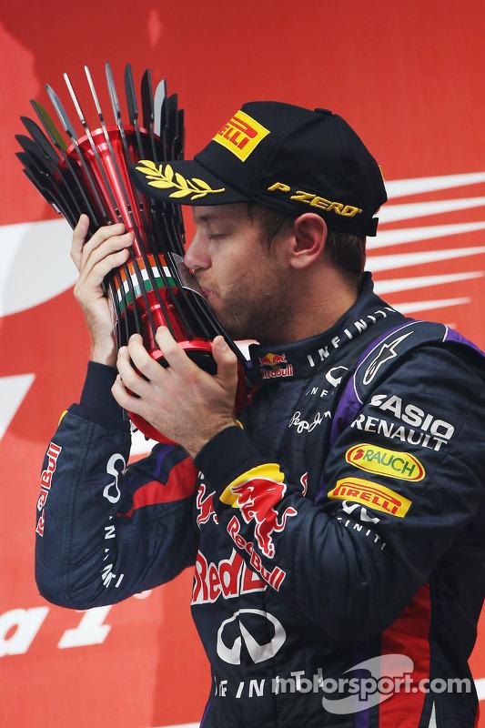 Race winner and World Champion Sebastian Vettel, Red Bull Racing celebrates on the podium