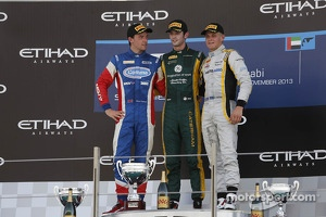 Second place Jolyon Palmer, race winner Alexander Rossi and third place Marcus Ericsson