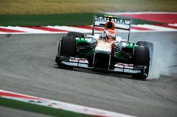 Adrian Sutil, Sahara Force India VJM06 locks up under braking