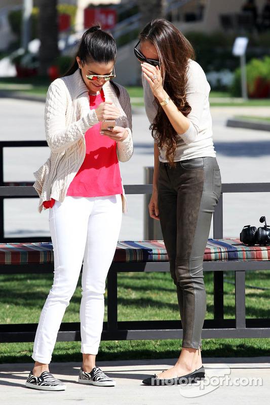 (L to R): Gabriele Tarkany, wife of Pastor Maldonado, Jessica Michibata girlfriend of Jenson Button,